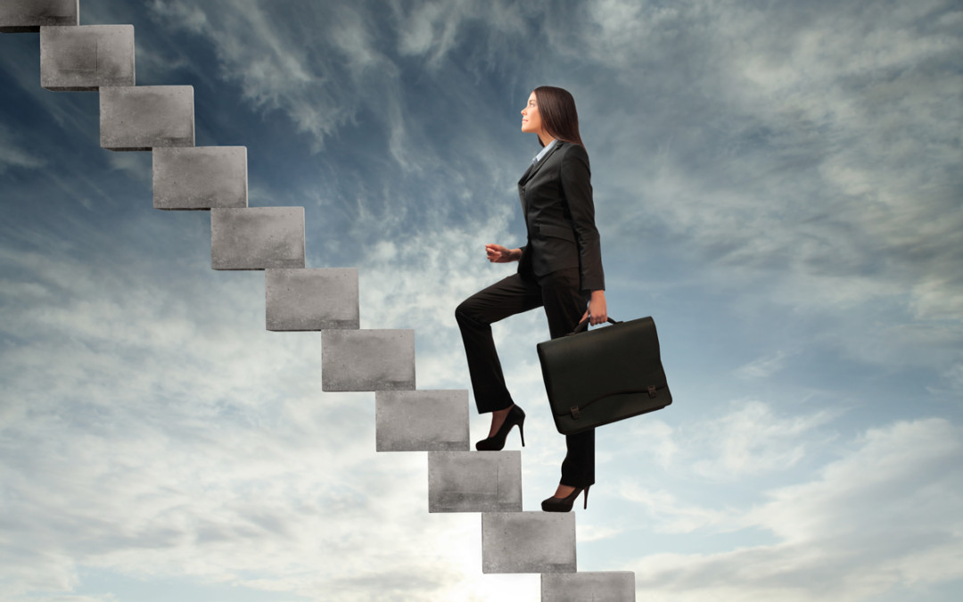 Setting goals - a business woman climbs one step at a time.